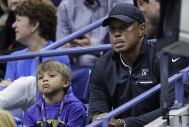Tiger Woods watches tennis at the US Open