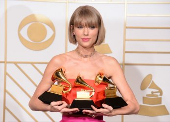 Taylor Swift wins award at the 58th annual Grammy Awards in Los Angeles