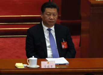President Xi listens to a speech during the NPC in Beijing, China