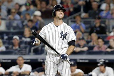 New York Yankees Brett Gardner reacts after taking a strike