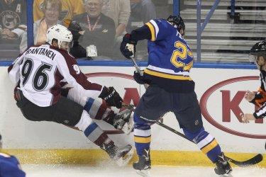 St. Louis Blues Alex Pietrangelo pushes Colorado Avalanche Mikko Rantanen off of his skates