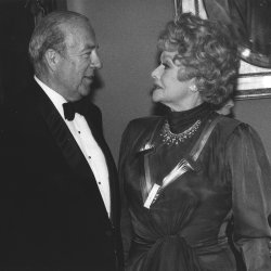 Secretary of State George Schultz chats with comedian Lucille Ball