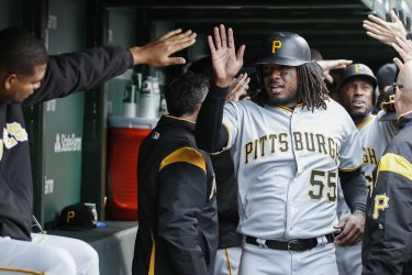 Pirates Josh Bell scores against Cubs in Chicago