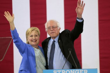 Hillary Clinton hugs Bernie Sanders after his endorsement at campaign event in Portsmouth, New Hampshire
