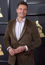 Ryan Seacrest arrives for the 59th annual Grammy Awards in Los Angeles