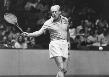 Former President Gerald Ford misses a backhand in tennis