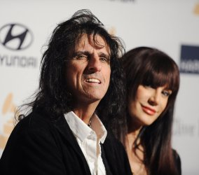 Musician Alice Cooper and Sheryl Goddard  attend the Clive Davis pre-Grammy party in Beverly Hills, California
