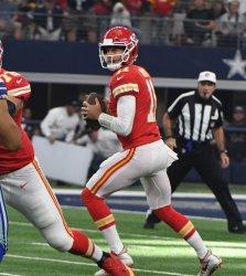 Kansas City Chiefs Alex Smith rolls out against the Dallas Cowboys