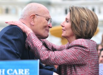 Rep. John Dingell embraces Speaker Pelosi during an event onhealth care reform in Washington