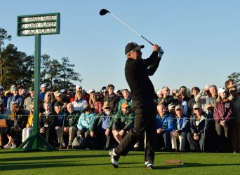 Honorary starter Gary Player hits a tee shot at the Masters