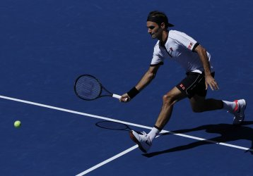 Roger Federer hits a volley at the US Open