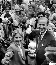 Senator Joseph Biden of Delaware and his wife Jill  making their way through a crowd of well-wishers and photographers.
