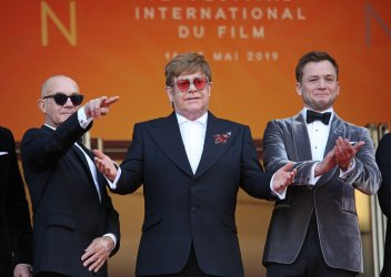 Taupin, John and Egerton attend the Cannes Film Festival