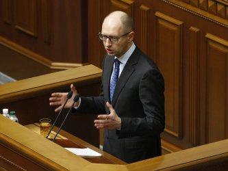 Ukrainian Prime Minister Arseniy Yatsenyuk speaks in the parliament