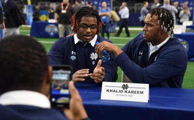 Notre Dame players and coaches take part in Media Day at AT&T stadium