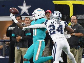 Dolphins DeVante Parker makes a one-handed catch as Cowboys Chidobe Awuzie