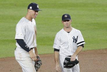 Yankees Brett Gardner and Aaron Judge celebrate