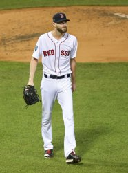 Red Sox' picher Chris Sale walks to dugout during World Series Game 1