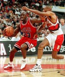 Michael Jordan drives past Atlanta Hawks Steve Smith