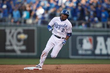 Royals' Alcides Escobar runs for a triple against the Astros