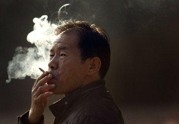 Man smokes cigarette in Beijing