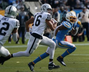Oakland Raiders receiver Tyrell Williams (16) gets by Los Angeles Chargers safety Rayshawn Jenkins