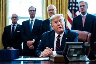 President Trump signs the Coronavirus Relief Bill at the White House