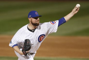 Chicago Cubs starting pitcher Jon Lester throws a pitch