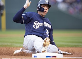 Brewers Yelich slides safely into third in first inning in NLDS Game Three