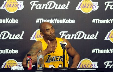 Los Angeles Lakers Kobe Bryant speaks to the media after his last game