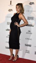 Model Chrissy Teigen walks the red carpet during the Sports Illustrated 2016 Fan Festival