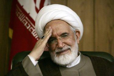 Iran's former Parliament speaker Mahdi Karroubi holds a press conference