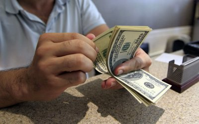 Iran's currency falls to record low against the dollar