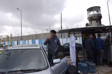 Palestinians At The Qalandiya Checkpoint Between Jerusalem and Ramallah