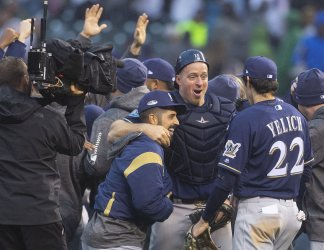 Brewers Kratz and Yelich celebrate sweep of Rockies in NLDS Game Three