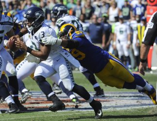 Rams Aaron Donald tackles Seattle Seahawks quarterback Russell Wilson in Los Angeles, California