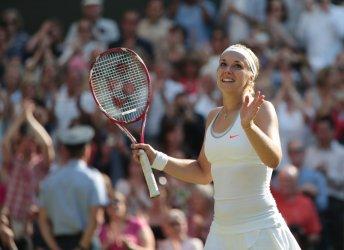 Sabine Lisicki celebrates victory over Agnieszka Radwanska