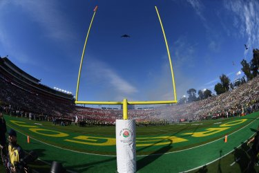 The B-2 Stealth Bomber flies through the goal post prior to the 106h Rose Bowl