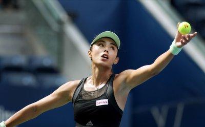 Qiang Wang serves at the US Open