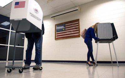 Voters cast their ballot in the 2018 Midterm Elections in Virginia