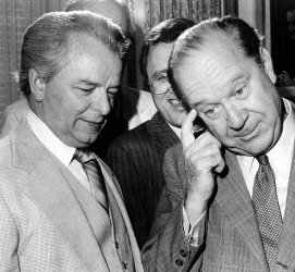 SENATORS ROBERT BYRD AND RUSSELL LONG SPEAKING AFTER A PRESS CONFERENCE