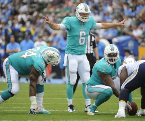 Dolphins' Jay Cutler calls a play in the first half against the Los Angeles Chargers in Carson, California