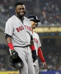 Red Sox David Ortiz smiles on 3rd base with Mookie Betts