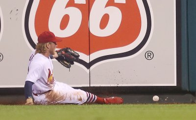 St. Louis Cardinals Harrison Bader chases down ball