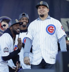 Kyle Schwarber arrives on stage for the 2016 World Series Champion celebration rally in Chicago