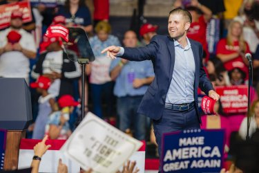 Eric Trump Tosses Hats at a President Trump Rally
