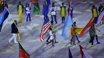 American Biles carries flag at Closing Ceremony at the 2016 Rio Summer Olympics