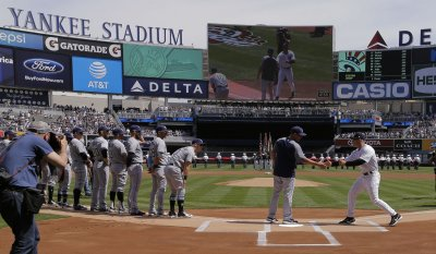 Tampa Bay Rays manager Kevin Cash greets New York Yankees manager Joe Girardi