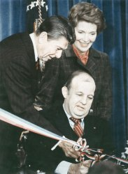 Press Secretary James Brady and President Ronald Reagan open new press center at the White House