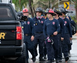 New Rescue Workers Arrive at Partially Collapsed Building in Surfside, Florida